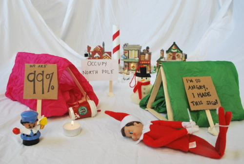 Occupy North Pole 2011 - When Keeping it Real, Goes Wrong Santa got a little pissed at the inappropriate protesting the elves were doing, so he sent for reinforcements from the NYPD. THis is for a contest that Jill at Baby Rabies is having! To view more submissions and learn about the contest go to http://www.babyrabies.com/2011/12/inappropriate-elf-contest/