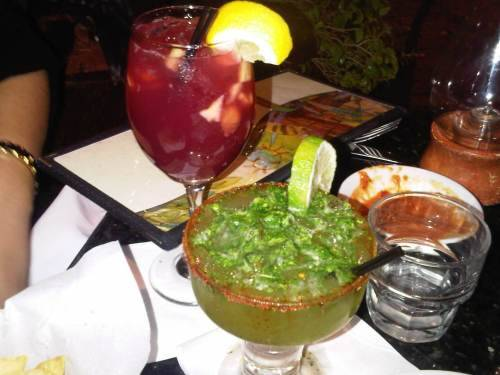 thegrubdaily:  Glass of Red Sangria and Cilantro Margarita