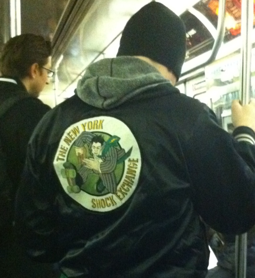 wnyc:  Spotted on morning train- The New York Shock Exchange! Great logo for a men's roller derby team, apparently.