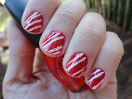 My candy cane nails!  They are a little messy, but otherwise I think they are pretty. The idea came from http://www.youtube.com/watch?v=iX7GyN12h74&list=PL0F4C0C0BFC54B9EF&index=5&feature=plpp_video