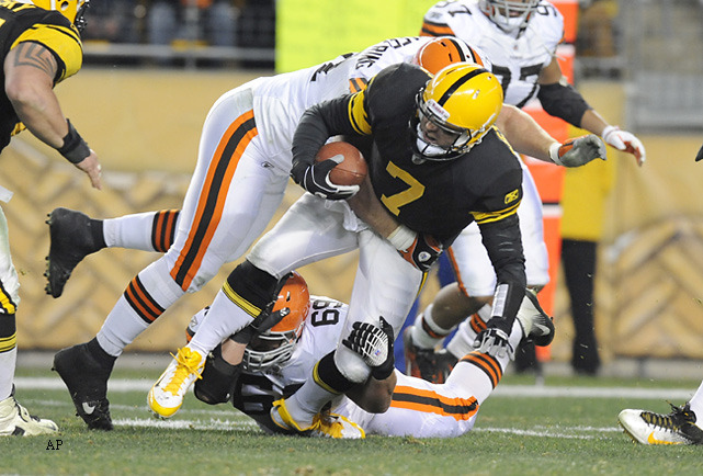 Steelers quarterback Ben Roethlisberger is injured by Browns nose tackles Scott Paxson (69) and Brian Schaefering (91) in the second quarter of Thursday night's game. Roethlisberger was helped from the field, but returned in the second half as the Steelers won 14-3. (AP Photo/Don Wright) TROTTER: Roethlisberger comes in fourth in the NFL Quarterback RankingsKING: Panthers will top Falcons and other predictions for Week 14BANKS: With four weeks remaining, the playoff races are up in the air