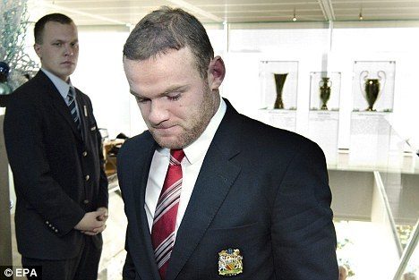 Never, EVER underestimate the power of a blazer. Wayne Rooney's UEFA Euro 2012 ban reduced to two games. (photo via Daily Mail)