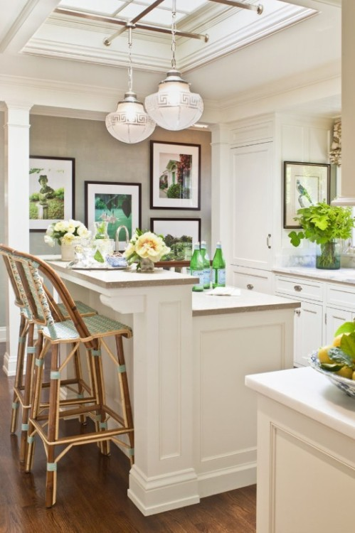 Such a light and lovely kitchen. I love the recessed ceiling skylight and the Greek key light fixtures. (via Great Kitchens / pretty kitchen)