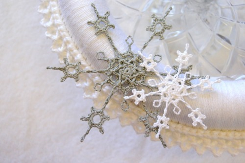 I've been playing with my snowflake design! Next up: metallic silver thread.