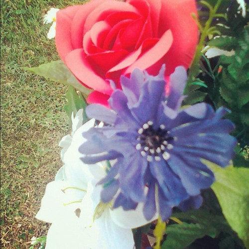 Red, white, and blue on my great-grandfather's grave. He served in WW2. #photography #tombstone #graveyard #cemetery #pretty #fauxflowers #red #white #flowers #blue #veteran (Taken with instagram)