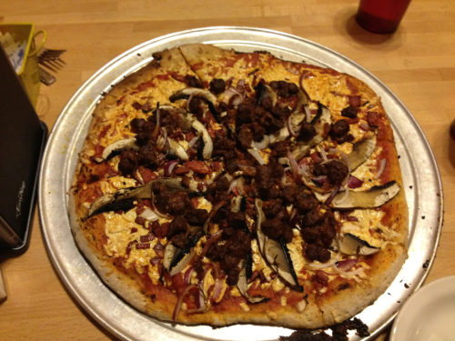 "reblogged from nastynate500:  Vegan pizza from Green in san antonio, tx.  onion, portobello mushrooms, daiya ""cheese"", with house-made chopped BBQ and wham.   ooooooooooh yes please!"