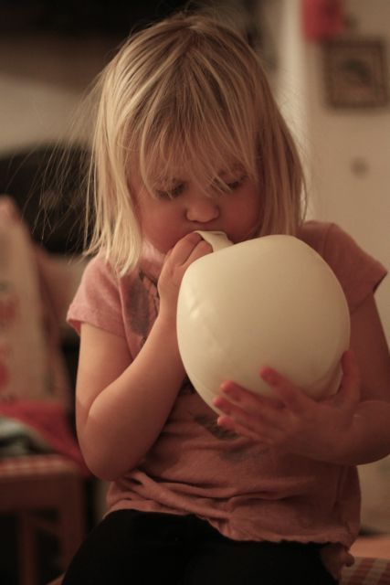 sin-vida:  Step one: Blow up a balloon. Step two: Soak any piece of cute cloth or lace in wallpaper glue. Step three: When putting the cloth on the balloon, make sure the sides overlap each other so it stays formed once balloon is gone. Let dry overnight. Step four: Pop the balloon, attach string, hang!