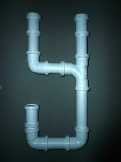 PVC Pipe type & poster Creating a font that was related to flooding by using pvc pipes and then creating a poster with a positive message for comm unties in Britain who were victims of flooding.