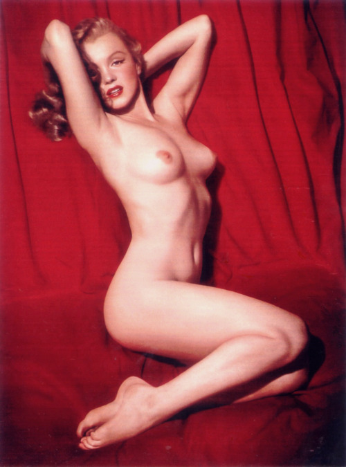 "pussylequeer:  Marilyn Monroe photographed by Tom Kelley in 1949 ""Reflecting on the Marilyn Monroe nudes, Kelley remembers that he posed the out-of-work actress on a bolt of bright red velvet cloth. She was paid $50.00 for her modeling, telling Kelley that she would use the money to make an installment on her car. In retrospect, Kelley is proud of the fact that no matter how one turned the photograph, its composition was impeccably symmetrical. The Photograph, turned calendar, brought him $900.00 from a printer who sold it in quantity for millions. It also brought Kelley untold fame.Strangely, in a sense, Kelley nudes of Marilyn were to prove to be the catalyst in the sexual revolution occurring some five years after he made the photographs. Up until that time, the nude female form was relegated to a few sleezy pre-Playboy-type girlie books if not out- and-out hardcore pornography. To be sure, one distinguished publication did print nudes; however, the National Geographic's genre of undraped, unsightly epidermis and/or dangling mammary glands could hardly be classified with a contemporary Playboy centerfold. But Kelley and Marilyn made the naked body a thing beautiful to behold. No longer was a nude picture of a beautiful woman an object to be viewed from the rear of the barn or the secrecy of one's bedroom. Marilyn readily admitted that it was she who had posed for Kelley's camera when confronted by United Press Hollywood correspondent Aleene Mosby. And for years thereafter, she would autograph copies of the calendar for servicemen with consummate pride."" - Norman Mailer"