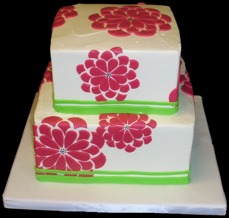 Zingerman's Bakehouse - Groovy Wedding Cake Graphic flowers, hand-cut from bright pink fondant were created to mimic the couple's wedding invitation.  Very groovy baby. Source: Zingerman's Bakehouse Website