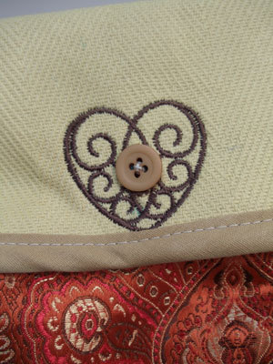 this is a cute idea!  embroider around a buttonhole