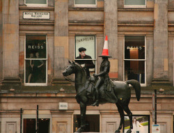 "Take a stroll down Glasgow's Queen Street past the Gallery of Modern Art on any given day and you might see a traffic cone sitting on the head of the statue of the Duke of Wellington. For the last 20 years or so, Glaswegians have been, despite requests from the police, crowning the Duke (and sometimes his horse!) with various cones in the middle of the night. The police remove the cones in the morning, but it won't be long until another takes the last one's place. I suppose you can say it's become of a bit of a tradition. After all, as proved again by reactions to ""Hurricane Bawbag"", no one has a sense of humour like the Scottish."