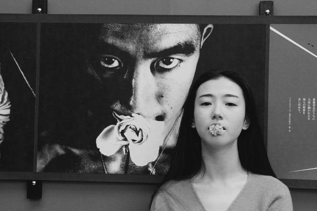 sacraments:  Zhang Xin Yuan in front of Yukio Mishima, Ordeal of the Roses #32, Eikoh Hosoe, 1961