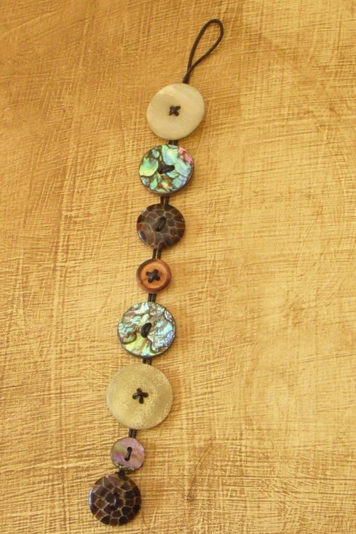 DIY Easiest Cheapest Button Bracelet Ever (that looks good if you pick the right buttons). You could use braiding cord or leather cord in any color you want and add beads. I like how she made the buttons look sewn on. Tutorial Hope Studios here.