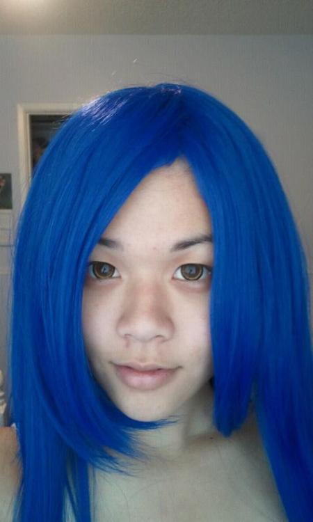 Progress pictures for Wendy Carvell of Fairy Tail. Got the contacts and wig, just need to cut the bangs and style the hair.
