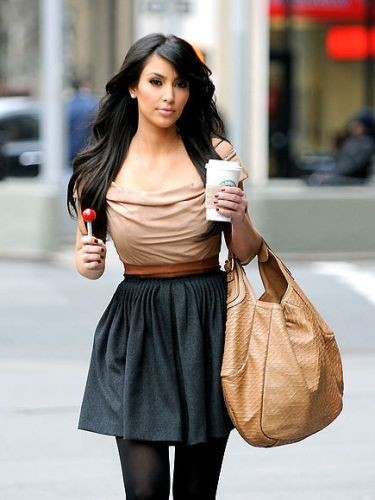 Kim K got it right with this outfit. She has a good balance between a fitted top with a flowly skirt and of course sky high heels. This type of flowly skirt is a big hit this season; For the winter, try a solid print skirt with patterend tights. Photo via Pinterest