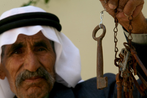 """Palestinian refugee Mahmoud Amer, 75, shows the keys of his home in the village of Mansi in what is now Israel on May 15, 2011, in the West Bank refugee camp of Jenin."""