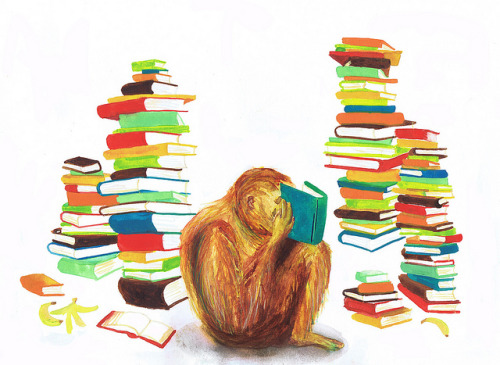 The Librarian / orangutan reading a book  by naomese on Flickr.
