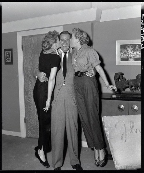 Lucille Ball, John Wayne, and Vivian Vance behind the scenes of I Love Lucy with Wayne as a guest star.