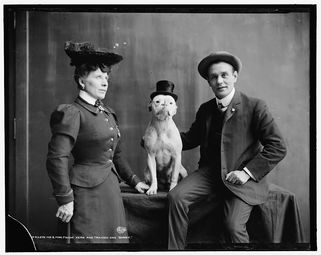 Victorian family with dog in top hat. Late 1800s-early 1900s.