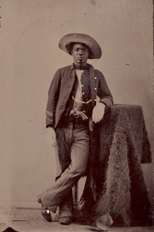 Portrait of unidentified buffalo soldier with buffalo hide and gun circa 1860-80. via Yale University, Beinecke Rare Book and Manuscript Library, Photographs of Afro-American Soldiers Collection & tuesday-johnson