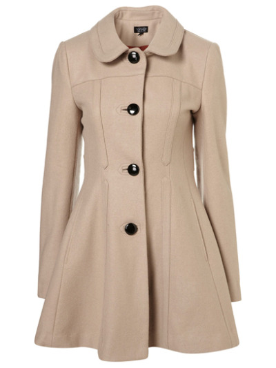 """Wear a skirted coat over a '40-style frock for an ultra femme look."" Topshop.com."" Check out more ways to wear retro fashion here » via teenvogue"