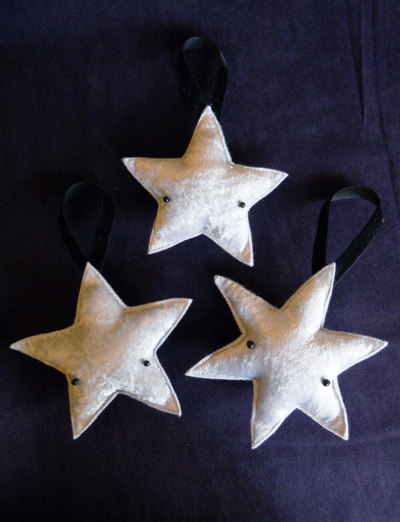 Silver star christmas decorations. The little eyes are so cute. For sale here.