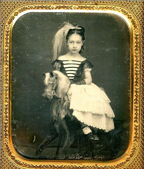 turnofthecentury:  tuesday-johnson:ca. 1850's, [portrait of a young girl on a rocking horse]  via Live Auctioneers, Be-Hold