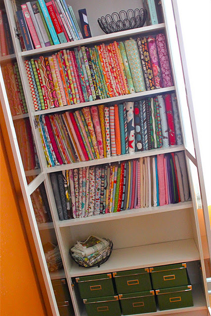 internationalsewingpatterns:  check out how neat this fabric stash is!  she gives a tutorial on how to fold the fabric and use comic storage boards which have archival properties not just plain old cardboard.