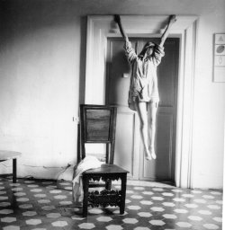 "suicideblonde:  Francesca Woodman's Enduring Appeal When she took her life by jumping out a Manhattan loft window in 1981 at just 22, photographer Francesca Woodman left behind a prodigious body of work. And not surprisingly, it is difficult to read her work separate from the story of her short life. C. Scott Willis' documentary The Woodmans (playing at the Film Forum in New York until February 1) aims to go further by investigating not just Woodman, her journal and her photographs, but also her family—a family of disciplined, loving and competitive artists.In the film, parents Betty and George Woodman stress that their daughter's photos are merely genius on their own, and more importantly, that there is nothing dark about them. She felt joy from the vision she communicated, and recognized her depression only when she wasn't producing. In her characteristic black and white nude self-portraits, Woodman challenges the borders of her surroundings by merging with them—be it the wall or bathtub, or even the wall or light around her. When Woodman selectively covers her nude body in peeling wallpaper as if it's lingerie, or hangs from a doorframe, it is illuminating to know she was a force of a young woman, and not a sad one. To know her more than just her work or the story of her death, is to really appreciate her.Woodman was also a lover of fashion. In the film, her father tells of her first drawings—copied from portraits elaborately costumed women, such as Velazquez' Las Meninas. This translated to her personal style. When she is not nude in her photos, she is wearing statement frocks and has a pile of unkempt hair. She is described as having a ""rock star"" quality among her school peers, and a bevy of characters remember her for her intense sexuality, or wearing her ""skin inside out."" During her time studying abroad in Italy, the film notes how she was noticed for the striking contrast between her yellow-blonde hair and black fur coat.We learn that once Woodman graduated form RISD and moved to New York, she searched for work in the fashion photography world, and began by loading film as an assistant. Photo rep Glenn Palmer-Smith recalls a memory of meeting her: ""So here I am, I'm spending my life addressing the ego of an Italian fashion photographer, meanwhile in the studio here's one of the great photographers of the twentieth century under everyone's nose.""The photograph is the ultimate medium for recording fashion—it captures an ideal, specific moment in time. Sometimes those moments become contemporary classics, and if you stare at them hard enough, they move. As Woodman wrote, ""I wish I could change minds as easily as I change socks. But then I don't change socks so easily."" photo credit: Untitled (1977-78, Rome) by Francesca Woodman"