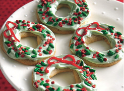 Merry Berry Wreath Cookies  INGREDIENTS 1 roll (16.5 oz) Pillsbury® refrigerated sugar cookies1 container (1 lb) vanilla creamy ready-to-spread frosting4 or 5 drops green food color2 tubes (0.68 oz each) red decorating gelAbout 2 tablespoons holiday red and green candy decors DIRECTIONS 1. Heat oven to 350°F. Remove half of cookie dough from wrapper; refrigerate remaining dough until needed. Cut dough into 12 slices, 1/4 inch thick. On floured work surface, roll each into 6-inch long rope. On ungreased cookie sheet, form into wreath shapes 2 inches apart; pinch ends of each wreath together. 2. Bake 9 to 12 minutes or until edges are light golden brown. Cool 1 minute. Remove from cookie sheet to cooling rack. Cool completely, about 15 minutes. Repeat with remaining half of cookie dough. 3. In medium bowl, mix frosting and food color until well blended. Frost tops of cookies. With decorating gel, form bow at top of each wreath. Sprinkle with candy decors.