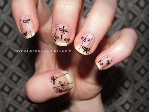 Bows and Lines.  Here are some hand drawn bows and lines over a bare nail. Polish used: Models Own black nail art pen