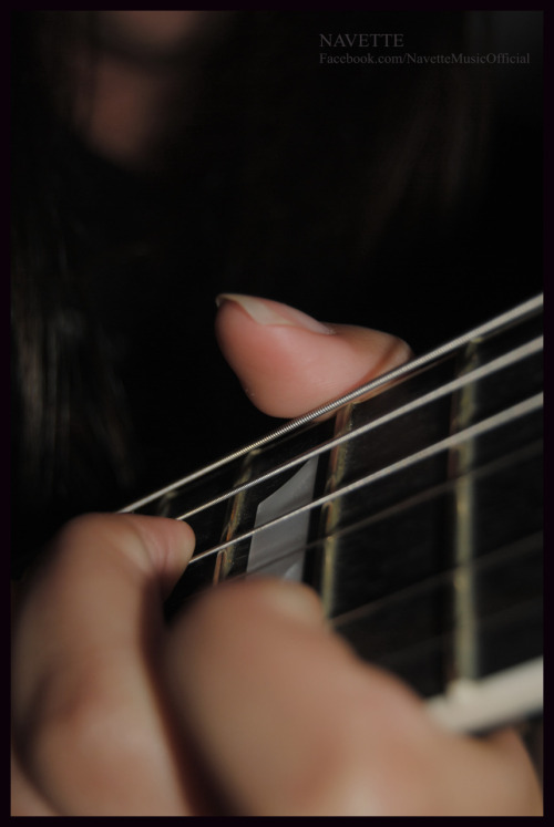 My hand/ photography/ guitar.