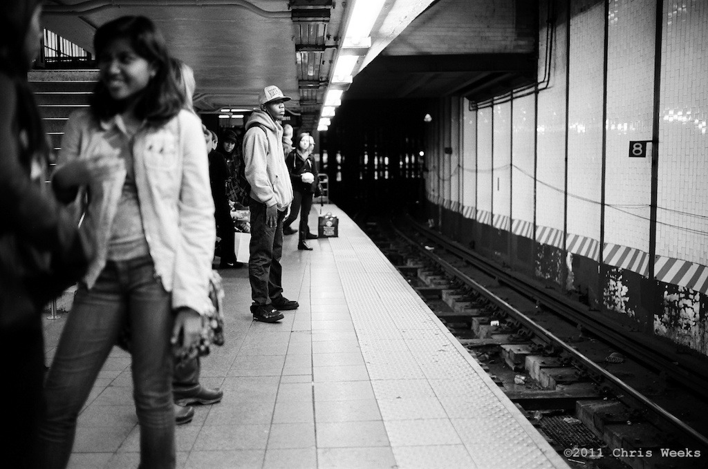 NYC, New York:  October, 2011.   Peaceful chilling waiting for the train.   Leica MP.  35 'lux.  Lab scan »> Aperture.  (Fuji Neopan 400, Rollei Pan 25  and Agfa APX 25 with or without ND)