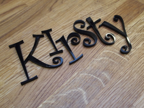 Laser cut letters in 5mm glossy black acrylic.