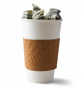 Paper coffee cup with money inside
