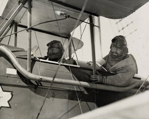 """Sir Douglas Mawson and Flying Officer Campbell leaving the Discovery in a Gipsy Moth to survey newly discovered Antarctic Lands."" (via)"