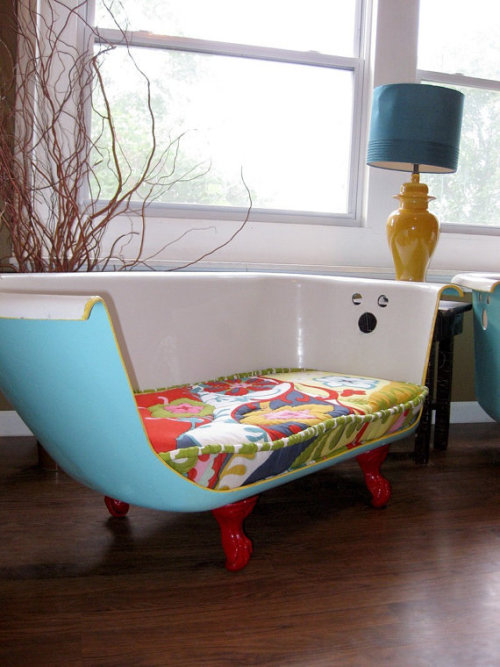 craftovision:  dwellings:  bathtub couch, a la Breakfast At Tiffany's  A little weird but a lotta awesome.  i don't know what's more amazing: a bathtub couch, or the fact that i know someone with a bathtub like this just sitting in their backyard.