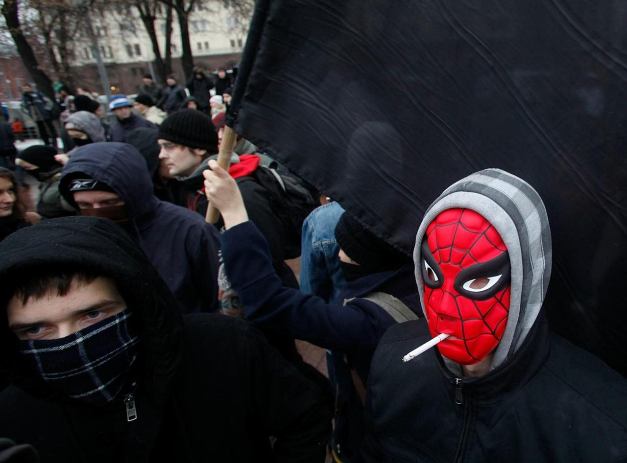 nickturse:  Masked protesters seen during a mass rally to protest against alleged vote 	      rigging in Russia's parliamentary elections in Moscow, Russia, Saturday, 	      Dec. 10, 2011. Russians angered by allegedly fraudulent parliamentary elections 	      are protesting Saturday in cities from the freezing Pacific Coast to the 	      southwest of Russia, eight time zones away, a striking show of indignation, 	      challenging Prime Minister Vladimir Putin's hold on power. (Pavel Golovkin)