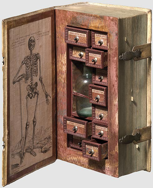 Secret poison case disguised as a book, 17th century I have no idea where it's from but it's pretty amazing.