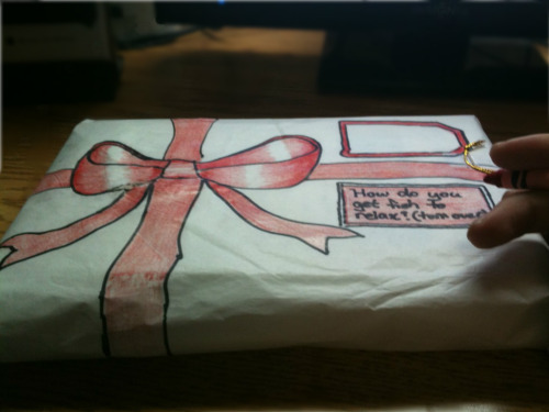 allpatchedup:  I didn't have a box, wrapping paper, or even a red marker… instead I just used a red crayon and the paper they use to wrap new shoes in. Not an artist by any means but I think it turned out okay! :-)