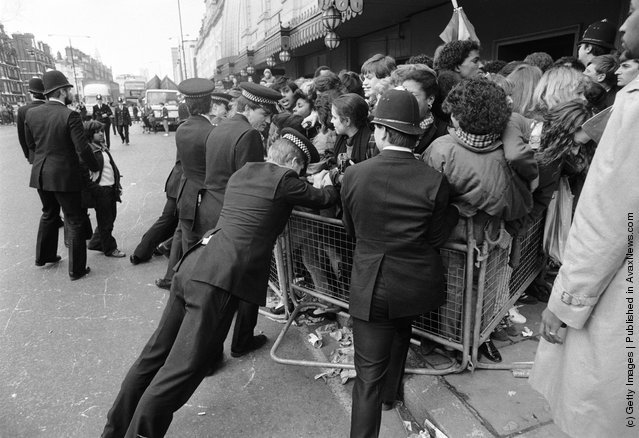 Police controlling a crowd of Michael Jackson fans outside Madame Tussauds.