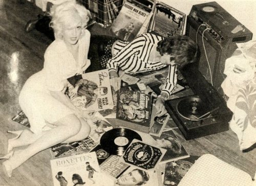 David Johansen and Cyrinda Foxe listening to music in their home.