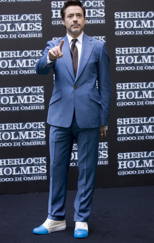 "Robert Downey Jr wore a Vivienne Westwood suit from the SS 2012 collection to the ""Sherlock Homes: A Game of Shadows"" Rome photocall. He looks great!"