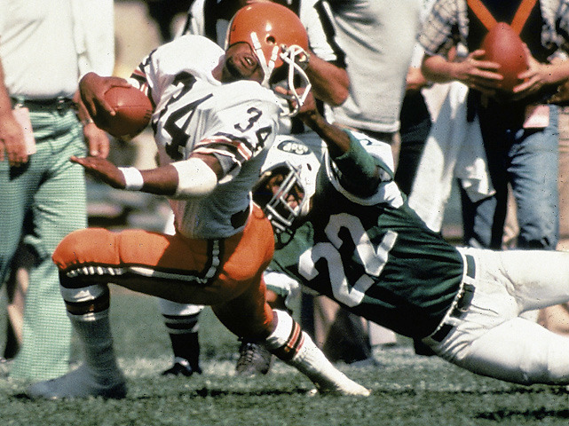 Browns running back Greg Pruitt gets his helmet turned around by Jets DB Burgess Owens during a 1978 game between the two teams. (Tony Tomsic/SI)