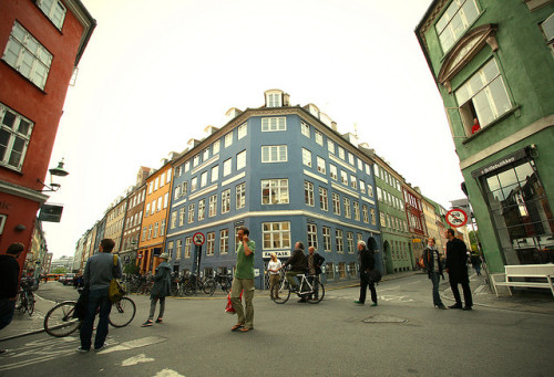 Colourful Copenhagen. The crossing of the two streets Sankt Peders Stræde and Larsbjørnsstræde in central Copenhagen, Denmark. I love the architecture and colours of some of the buildings in this city. The reason why some people are standing still here and also looking up to the left is because it sounded like there were two people fighting and throwing things up in an apartment. The photo is taken in May 2009.