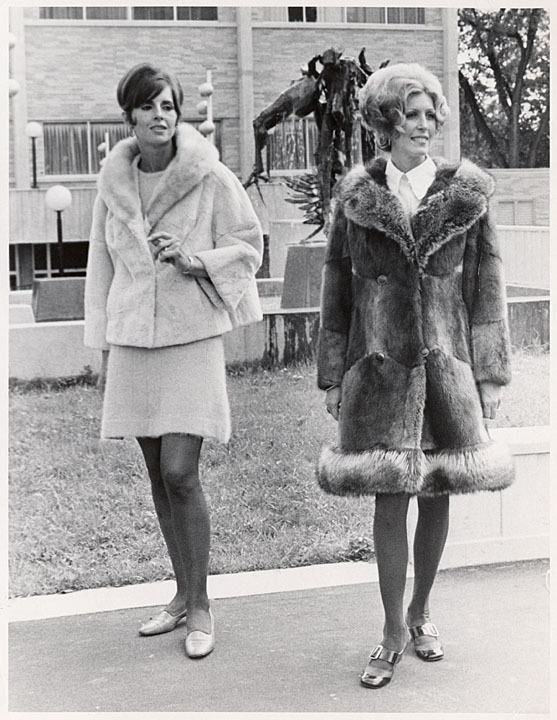 Two students model fur coats for a fashion show at the University of Wisconsin-Marathon County, 1973. via: University of Wisconsin-Marathon County by way of University of Wisconsin Digital Collections