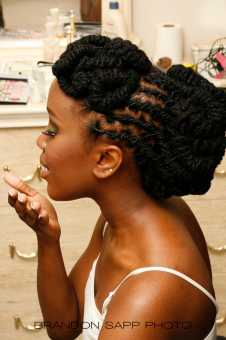 sisterlocked:  Wonderful style on traditional locks. prissyporsha:  love her locs <3
