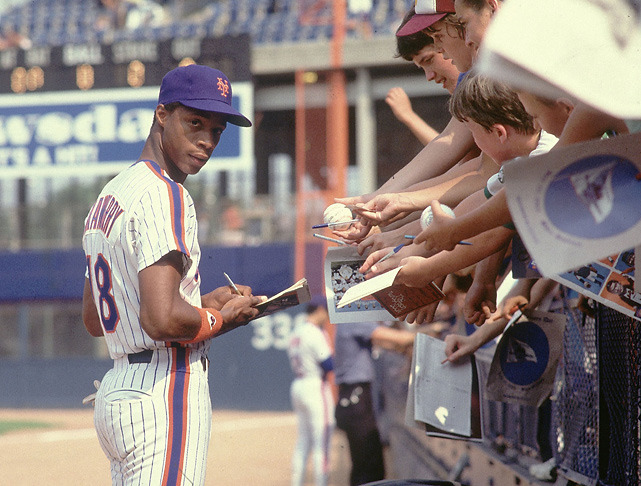 Mets outfielder Darryl Strawberry signs autographs for fans before a 1983 game against the Pirates. (Manny Millan/SI) VERDUCCI: Winner and losers from the winter meetings