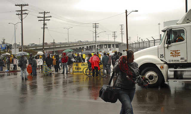 Occupy San Diego Port Shut Down (Dec. 12) on Flickr.Via Flickr: On December 12, West Coast Port Shut Down, Occupy San Diego protesters gather at the Northern entrance of the Port of San Diego to disrupt commerce for one day by blocking truck shipments.  (Johnny Nguyen)